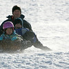 "Topsfield: Mia Jackson, 5, of Beverly leads her brother Ryan, 9, and dad Brad down Wheatland Hill on their wooden sled Saturday morning. Reacting to walking back up the hill, Ryan sighed,  ""It's exhausting!"" Photo by Deborah Parker/Salem News Saturday, January 24, 2009."