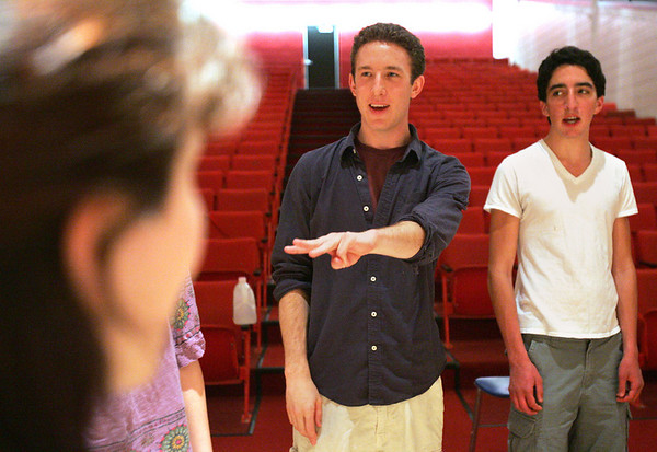 Alex Grover, director of Witch Pitch, an a cappella group at Salem High, leads a rehearsal Monday evening. Grover, who graduated from Salem High School in 2005 is now a graduate student at Boston University. The group will be having their first exclusive concert on Friday. Next to Grover is junior Craig Simonetti. Photo by Deborah Parker/May 24, 2010<br /> , Alex Grover, director of Witch Pitch, an a cappella group at Salem High, leads a rehearsal Monday evening. Grover, who graduated from Salem High School in 2005 is now a graduate student at Boston University. The group will be having their first exclusive concert on Friday. Next to Grover is junior Craig Simonetti. Photo by Deborah Parker/May 24, 2010