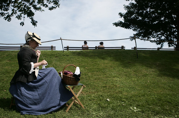 Dressed in period clothing, Pam Witham of Essex, sews a cloth while at Glovers Regiment Encampment at Fort Sewall this weekend. Photo by Deborah Parker/ July 11, 2009