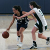 Boston: Swampscott's Marissa Gambale is defended by Pentucket's Erin McNamara during the Division 3 Final game Saturday at Emmanuel College. Photo by Deborah Parker/Salem News Saturday March 7, 2009.