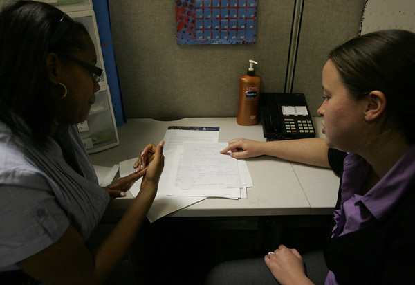 Salem State College freshman Miguelina Mesa talks with Kelly Quinn a college success counselor with Slame CyberSpace, a program launched last fall to help low income Salem studens succeed in college. Photo by Deborah Parker/April 22, 2010<br /> , Salem State College freshman Miguelina Mesa talks with Kelly Quinn a college success counselor with Slame CyberSpace, a program launched last fall to help low income Salem studens succeed in college. Photo by Deborah Parker/April 22, 2010