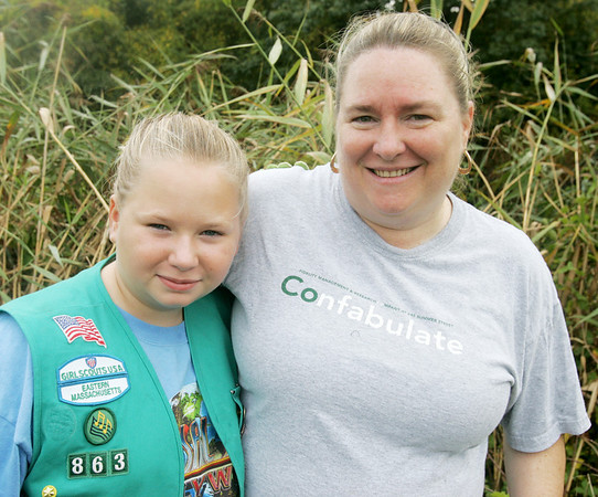 Eileen Browne and Shannon Browne, 10, of Lynn Troop 60863 helped to clean up Winter Island this weekend.  Over 170 Girl Scouts and their families, and adult volunteers inconjunction with University of Massachusetts-Boston Coast Sweep program worked to clean up the Massachusetts Coastline at Winter Island in Salem as part of the International Coastal Clean up. PHoto by Deborah Parker/October 4, 2009