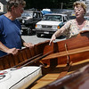 Stephen Mack of Rhode Island and Sharon Shea of Salem check examine an antique row boat during the Antique and Classic Boat Festival held at Hawthorne Cove Saturday. Photo by Deborah Parker/August 22, 2009