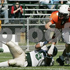 Beverly : Beverly's Mark Hannable escapes the sack by Lynn Classical's Darrell Lane during yesterday's game held at Hurd Stadium. Photo by Deborah Parker/Salem News Saturday, September 20, 2008