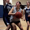 Wenham: Ipswich eight grader Maddie Howe is defended by Hamilton-Wenham's Sarah Walsh in front of the net while competeing in  North Shore girls travel basketball Championships held at Gordon College Saturday morning. Photo by Deborah Parker/Salem News Saturday, March 21, 2009.