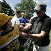 "Boston Bruins goaltender Tim Thomas signs the shirt of Dillon Horgan, 11, of Stoneham before the start of Boston Bruins Foundation's ""Swing Like Happy Gilmore Long Drive Contest"" held at Golf Country in Middleton Tuesday.  Photo by Deborah Parker/September 1, 2009"