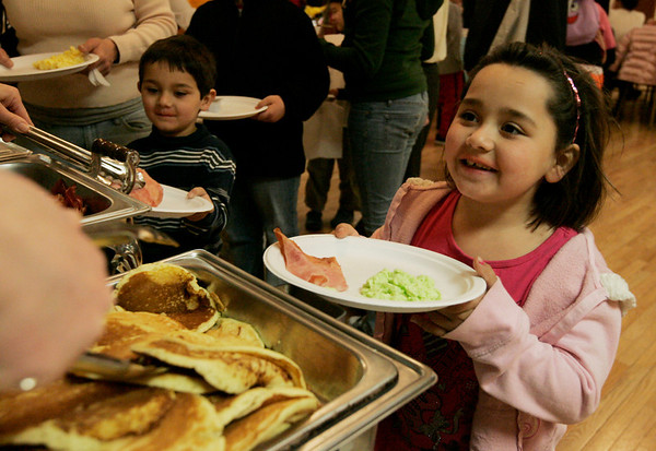 Beverly: Tabitha Adjemian, 7, of Beverly asks for some pancakes to accompany her plate of green eggs and ham while the Italian Community Center Saturday morning. The Kiwanis Club held a breakfast, complete with characters and free books,  to celebrate Dr. Seuss' 105th birthday. Photo by Deborah Parker/Salem News Saturday, March 21, 2009.