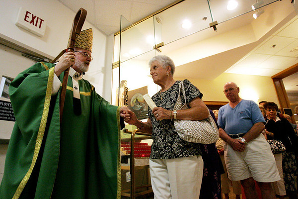 Cardinal Sean O'malley greets Jean McQuillan of Middleton following a Jubliee Mass and blessing at the Saint Therese Carmelite Chapel at the North Shore Mall. The Chapel was celebrating it's recent renovation. Photo by Deborah Parker/July 28, 2010