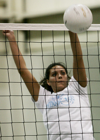 PEABODY ROP: Peabody volleyball player Brianna Waldrop blocks a spike during practice at the high school yesterday afternoon. Photo by Deborah Parker/September 2, 2009