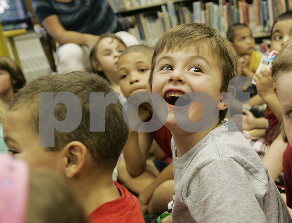 Salem: William Bouldry, 5, giggles with delight as he hears his new principal, Diane O'Donnell, on the loud speaker for the first time during orientation for new students at the Horace Mann Laboratory School. New kindergarten along with their parents were given a tour of the school, participated in a scavenger hunt and were given books to take home in preperation for their first day of school Monday. Photo by Deborah Parker/Salem News Thursday, September 04, 2008