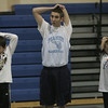 From left, Andrea Hamel, 12, of Peabody, Peabody High School junior Mike Gould and Jake Gustin, 11, of Peabody stretch together before the start of free youth basketball clinic in conjunction with the Tanner City Holiday Classic basketball tournament at Peabody High School Tuesday morning. photo by deborah parker/december 28, 2010