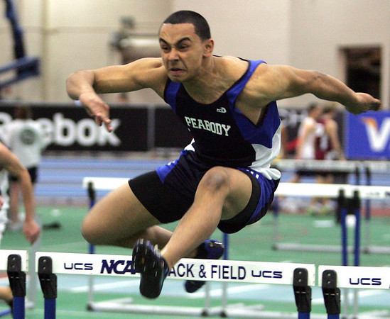 Peabody's Edwin Mejia competes in the 55 meter hurdles during yesterday's NEC Championship meet held at the Reggie Lewis Center in Boston. Photo by Deborah Parker/February 4, 2009