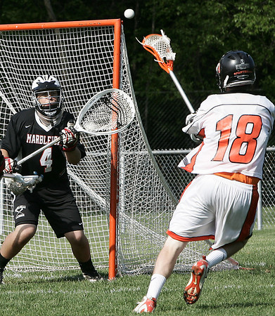 Beverly: Beverly's Dan Crowley shoots on Marblehead's Matt O'Neil for the goal during yesterday's game held at Hurd Stadium. Photo by Deborah Parker/May 15, 2009