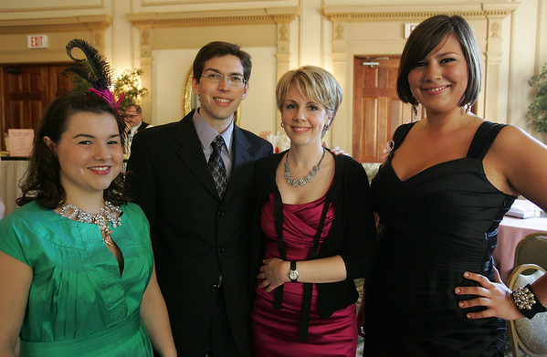 From left, Aimee Cole of Beverly, John Rodriguez of Somerville, Maggie Arnold of Beverly and Courtney Butcher of Ipswich attend the Miss Pink Pageant held at the Hawthorne Hotel Friday evening. Breast cancer survivors competed in the pageant to raise awareness and spoke about their experience with cancer. Photo by Deborah Parker/May 21, 2010