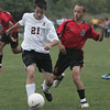 Beverly's  Brandon Sungy fights to maintain control of the ball while being defended by Salem's  Gabriel Polanco Rodriguez during Beverly's game against Salem Tuesday afternoon. Photo by Deborah parker/september 28, 2010