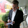 Mayoral candidate John Burke leaves a campaign brochure on the front porch of a Centerville neighborhood home on  the final day of campaigning in the Beverly mayor's race.  Photo by Deborah Parker/November 2, 2009