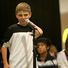 Holton Richmond sixth grade student Wess Milbury attempts to spell a word correctly during a spelling bee held at the Liberty Tree Mall to benefit  the Danvers DEEP educational enrichment partnership Tuesday night. The event was sponsered by Danversbank. Photo by Deborah Parker/November 10, 2009