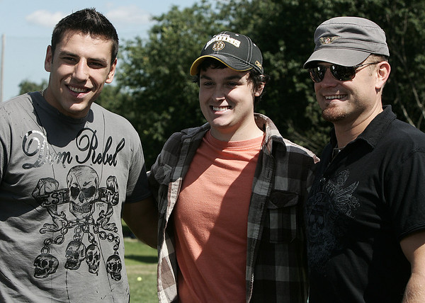 "Boston Bruins players Milan Lucic and Tim Thomas pose with James O'Blenes of Peabody, who dressed as Happy Gilmore, during the Boston Bruins Foundation's ""Swing Like Happy Gilmore Long Drive Contest"" held at Golf Country in Middleton Tuesday.  Photo by Deborah Parker/September 1, 2009"