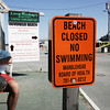 Devereux Beach is closed to swimming due to a high bacteria count in the water. Photo by Deborah Parker/July 10, 2009