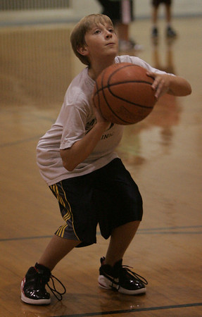Kyle Coughlin of Beverly works on his foul shot during a youth basketball clinic at the Shore County Day School in Beverly Monday evening. Photo by Deborah Parker/October 4, 2010
