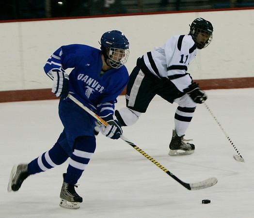 Peabody: Danvers' Brian O'Keefe (?) brings the puck down the ice against Peabody's Tom Linnane during Saturday's game in Peabody. Photo by Deborah Parker/Salem News Saturday, 20, 2008.
