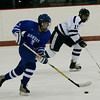 Peabody: Danvers' Brian O'Keefe (?) brings the puck down the ice against Peabody's Tom Linnane during Saturday's game in Peabody. Photo by Deborah Parker/Salem News Saturday, 20, 2008.