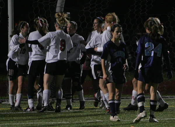 Winchester celebrates in front of the Peabody goal after scoring in yesterday's Division 1 North Semifinals held at Woburn High School. Photo by Deborah Parker/November 12, 2009