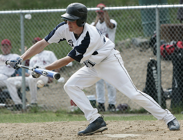 Peabody's Marc Linehan bunts the ball while at bat during yesterday's Division 1 North Baseball playoff game held at Peabody's Veteran's Memorial High School. Photo by Deborah Parker/May 31, 2009