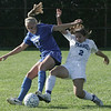 Danvers' Corey Persson and Peabody's Cayla Bucci try to gain control of the ball during Wedensday afternoon's game held in Peabody. Photo by Deborah parker/september 29, 2010