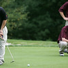 Members of the Newburyport golf team watch as Ipswich's Patrick Ryan putts on the third hole during yesterday's match at the Ipswich Country Club. Photo by Deborah Parker/September 22, 2009