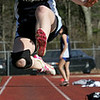 Peabody's Sarah Gingras competes in the long jump during yesterday's meet against Gloucester held at Peabody High School. Photo by Deborah Parker/April 5, 2010