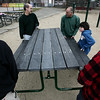 Salem: From left, Chris Casey of Marblehead, Jim Haskell of Ipswich, Dave Benson and his son Daniel of Danvers, and Trip Mason of Salem help to move a new picnic table while volunteering for the Salem Rotary Club who helped to clean up Mary Jane Lee Park in Salem Saturday morning. Photo by Deborah Parker/Salem News April 18, 2009.