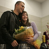 "Danvers: Engaged couple, Hadley von Bruns and Chris Johnson, both of Beverly, were ""ambushed"" with a suprise package called ""An Evening to Remember"" featuring gifts from local businesses while helping to wrap presents for Operation Troop Support at Holton Richmond Middle School Saturday. Here, the couple reaacts after they will be going to dinner at Pellana Steakhouse in Peabody as part of the surprise package. Chris, who has been serving in Iraq with the Marines since Janurary of this year, returned home for a 19-day leave. Chris will return to finish his tour next week. <br /> Photo by Deborah Parker/Salem News Saturday, November 15, 2008"