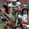 Hamilton-Wenham's Elliton Burr barely maintains control of the ball and escapes the tackle by  Ipswichduring their Thanksgiving football game held at Ipswich HIgh School. Photo by Deborah Parker/November 26, 2009