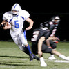 Marblehead: Danvers' Colin Cooper makes his way past two Marblehead defenders during last night's game at Marblehead. Photo by Deborah Parker/Salem News Thursday, October 24, 2008.