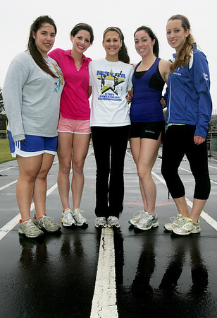 From left, Danvers track and field captians, Marlene Christenson, Christina Kaczynski, Megan Taylor, Maria Pantazelos and Taryn Pydynkowski. Photo by Deborah Parker/March 23, 2010