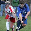 Masco's Lauren Padziorny and Danvers' Seth Kamens fight for control of the ball during Wednesday's state tournament gamed held at Masconomet High School. Photo by Deborah Parker/November 4, 2009