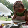 Nina Pierre, 2, of Mattapoisette, visiting her grandmother who lives in Beverly, takes a big bite out of her watermelon during the Lobster Festival part of this year's Beverly Homecoming. photo by Deborah parker/august 4, 2010