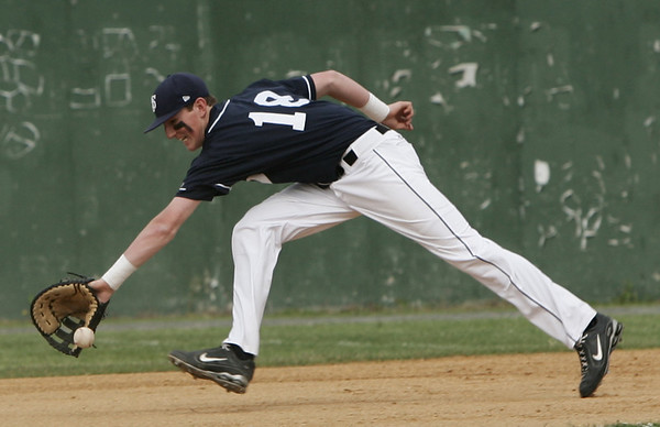 St. John's Kevin Davis stretches to catch a ground ball against Lowell in yesterday's Division 1 North Sectional Semi Finals game held at Alumni Field in Lowell. Photo by Deborah Parker/June 4, 2009