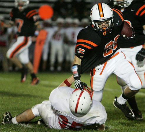 Melrose's Joe Sasso attempts to bring down Beverly's Curtis Manuel during last night's game under the lights at Hurd Stadium. Photo by Deborah Parker/September 17, 2009