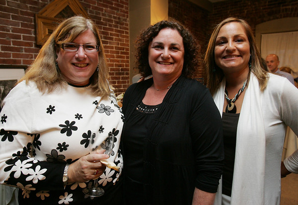 From left, Karen Gruskin of Marblehead, Julie Cummings, vice president of Northeast Arc and Tanja Lynch of Rhode Island, attend a wine tasting and silent auction held at the Lyceum Restaurant to benefit Northeast Arc. Photo by Deborah Parker/April 9, 2010