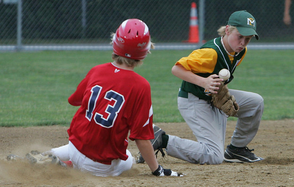 Manchester Essex's George Lantz fumbles the ball as Boxford's Jake Rutstein slides into second during yesterday's Williamsport tournament game held at Moulton Field in Danvers. Photo by Deborah Parker/June 29, 2010