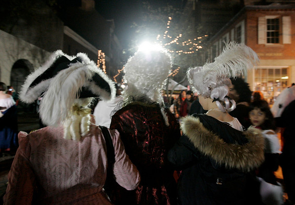 Salem: From left, Pamela Feingold of Chicago, Ana Eliason of Conneticut and Victoria Bielski, dressed as Victorian characters walk through crowded Essex Street. Photo by Deborah Parker/Salem News Friday, October 31, 2008.
