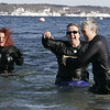 Salem: From left, Elizabeth Black of Beverly, Becky Christie of Salem and Maureen Oslon of Malden quickly make their way out of the water during yesterday's Polar Swim at Juniper Point Beach. This is the ninth year that a group of people have gathered to jump into the frigid water. Photo by Deborah Parker/Salem News Thursday, January 01, 2009