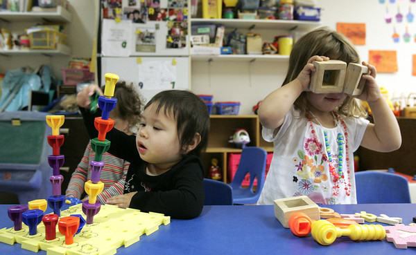 Beatrix Doeringer, 1, and Molly Blander, 2, play in their Prime Time class at the Jewish Community Center in Marblehead. The center nearly had to close due to the popularity of the new YMCA. Photo by Deborah Parker/October 15, 2010