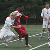 St. John's Ryan Palmer and Everett's Alain Jennty fight for control of the ball during yesterday's game held at St. John's Prep in Danvers. Photo by Deborah Parker/September 27, 2010