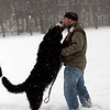 "Salem: Beckett gives a big kiss to his owner, Daniel O'Connor of Boston while playing in the snow covered Salem Commons Saturday afternoon. ""This dog loves snow more than any human I know,"" said O'Connor. Photo by Deborah Parker/Salem News Saturday, December 20, 2008."