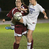 Danvers' Brittany Russo and Gloucester's Katina Tibbetts fight for control of the ball during Monday night's game held at Danvers High School. Photo by Deborah Parker/November 2, 2009