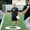 "Athletic trainer Patrick Downey calls out instructions to the Bishop Fenwick football team while working with them as part of his ""gridiron training"". Downey has started his own business working with many local high school players and teams. He is focusing on hardcore performance with individuals and specific teams. He previously served as a pro football strength and conditioning coach. Photo by Deborah Parker/September 30, 2009"