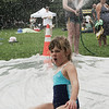 Lauren Booth, 6, of Beverly makes a splash while sliding down a tarp at Lynch Park on Sunday. The make shift slide was one of the many things kids could participate in at Tiny Tots Day at the park, part of Beverly Homecoming 2009. Photo by Deborah Parker/August 2, 2009